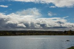 Rain clouds moving to the lake. Royalty Free Stock Photos