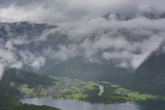 Rain and clouds on the Obertraun. In Austria. Morning mist over the Austrian landscape with lake Hallstattersee, forests, fields, pastures and meadows stock photography
