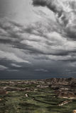 Rain clouds over Badlands National Park, South Dakota Stock Photos