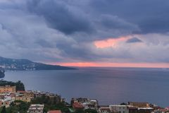Rain clouds over beautiful sunset Sorrento Bay in Italy stock image