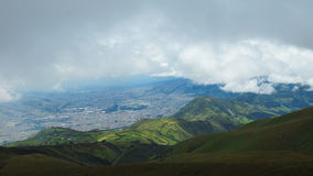 Rain clouds over the city of Quito Stock Photos