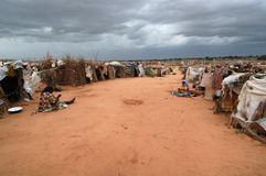 Rain Clouds Over Darfur Camp. September 22, 2004 -Rain clouds gathering over the Riyad camp near El Geneina, in East Darfur, Sudan. Most in these informal camps Royalty Free Stock Images