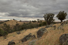 Rain Clouds Over Dry Farmland Stock Images