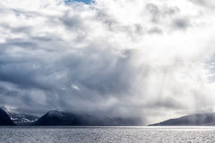 Rain clouds over Fjord royalty free stock photography
