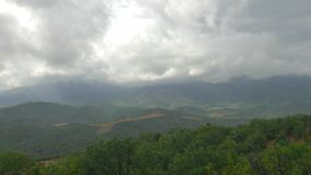 Storm clouds over green mountains, time lapse. Rain clouds over green mountains covered with forests, time lapse stock footage