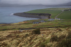 Rain clouds over ireland coast and green landscape.  Royalty Free Stock Photo
