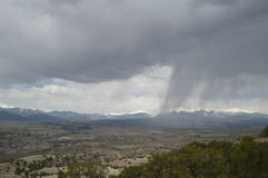 Rain clouds over mountains Stock Image