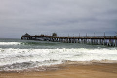 Rain clouds over Pacific Ocean pier Stock Photos