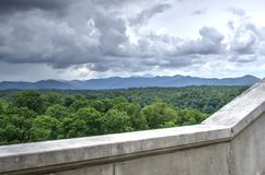 Rain Clouds over Pisgah Mountains, Biltmore Estate. Grey clouds over Pisgah National Forest mountains photographed from the back patio of the Biltmore Estate stock images