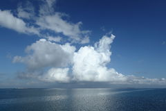 Rain clouds over the sea Royalty Free Stock Images