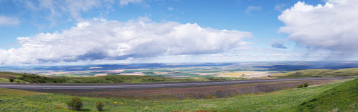 Rain Clouds - Panorama. The rain clouds are at eye level while observing the scenic view on top of Emigrant Hill in Eastern Oregon. Emigrant Hill, commonly Royalty Free Stock Photo