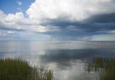 Rain clouds and rainbow Stock Photography