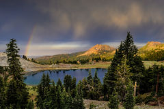 Rain Clouds and Rainbow over Lake Helen, Lassen Volcanic National Park. Rain clouds and rainbow over Lake Helen and Brokeoff Mountain at Lassen Volcanic National royalty free stock images
