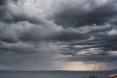 Rain clounds on river dramatic Stock Photo