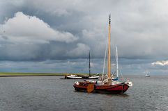 Storm clouds and sailboats Stock Image