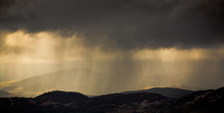 Rain clouds storm weather. Rain clouds raining, stormy mountain weather royalty free stock photo