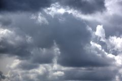 Rain clouds. Sunny day. Royalty Free Stock Image