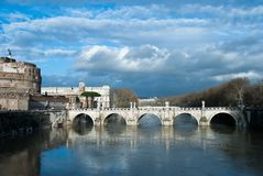 Rain clouds under the Tiber river and Bridge Ponte Sant` Angelo near of Castel Sant Angelo, Roma, Italy, February 2018. Water. Rain clouds under the Tiber river Royalty Free Stock Photo