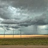 Rain clouds and wind turbines in South Texas Royalty Free Stock Photos