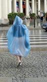Rain coat. Woman on rainy street with blue rain coat Royalty Free Stock Photography