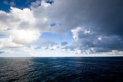 Rain coming. Rain clouds in the ocean Stock Photo