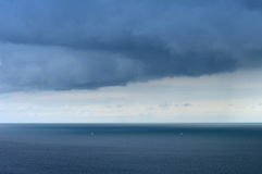 Rain coming. Rain cloud coming over the sea Royalty Free Stock Photos