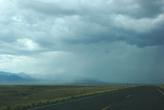 Rain is coming. Rainstorm is coming on the road Royalty Free Stock Photography