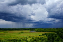 Rain Is Coming. Green Country landscape with dramatic sky Stock Photos