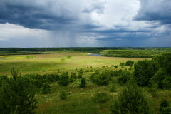 Rain Is Coming. Green Country landscape with dramatic sky Stock Photo