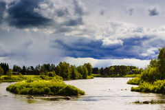 Rain Coming Over The River Bend Stock Photography