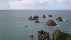 Rain is coming to Nugget Point stock video