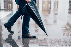 Rain weather in the city concept.Umbrella close up on rainy road Royalty Free Stock Photography