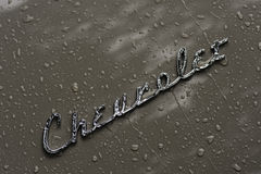 Rain covered car & Chevrolet logo Stock Photography