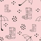 Rain. Cute seamless pattern with rubber boots and an umbrella. Vector decorative background for design Royalty Free Stock Photography