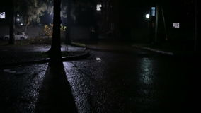 Rain in a dark courtyard at night. Follow stock video