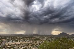Rain and dark storm clouds Stock Photo