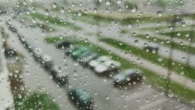 Rain days, heavy rain falling on window surface. stock video
