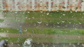 Rain days, heavy rain falling on window surface. stock footage