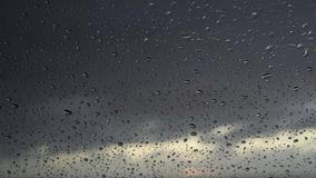 Rain days, heavy rain falling on window surface stock video