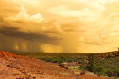 Rain in desert backside Stock Photo