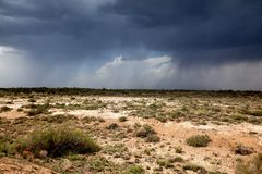Rain in desert Stock Photos