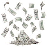 Rain of dollar bills and a heap of money isolated Royalty Free Stock Images