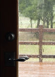 Rain Through the Door Window Royalty Free Stock Photo