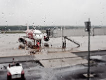 Rain dorps on the airport terminal's window Stock Photography