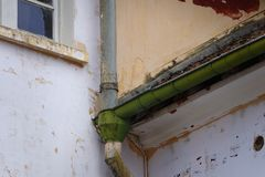 Rain downspout in an antique construction. Old rain downspout in an antique construction royalty free stock photography