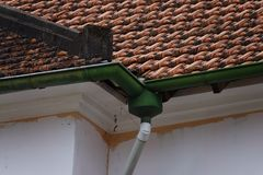 Rain downspout in an antique construction. Old rain downspout in an antique construction stock images