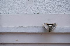 Rain downspout in an antique construction. Old rain downspout in an antique construction royalty free stock photos