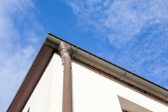 An rain drain from the roof. An rain drain pipe from the roof whit blue sky and clouds royalty free stock image