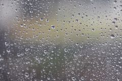 The rain drifted to the glass. Causing a drop of water. Spread the mirror on a rainy day, feeling lonely and lonely. Use as a back Royalty Free Stock Photography