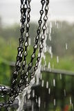 Rain dripping from a chain Royalty Free Stock Image